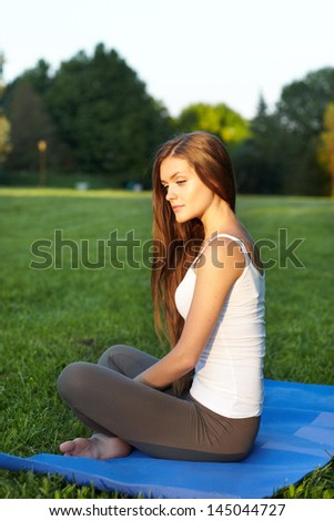 woman  on green grass relaxation. Outdoor - stock photo