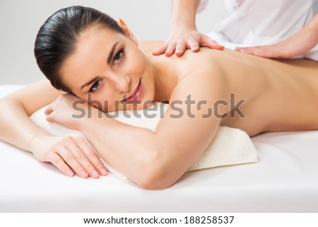 Woman on healthy massage of body in the spa salon. - stock photo