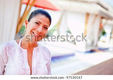 Woman on holidays at an outdoors spa - stock photo