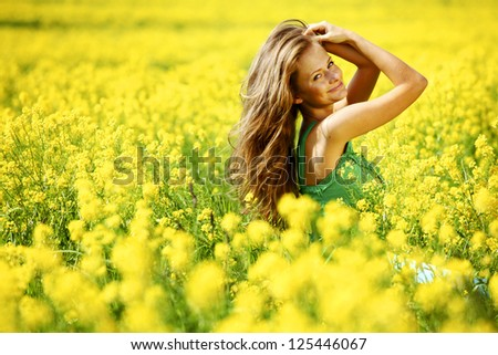 woman on oilseed field close portrait - stock photo