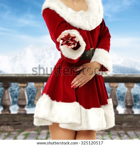 woman on terrace of winter time  - stock photo