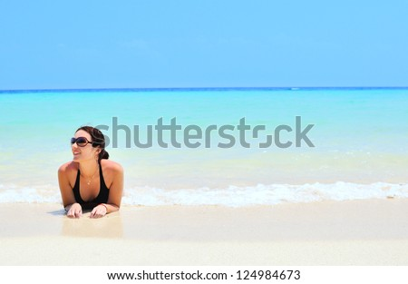Woman on the beach in Thailand - stock photo