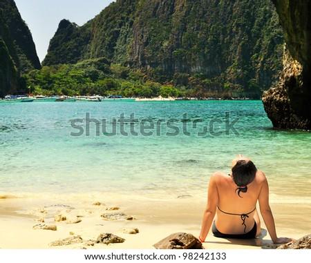 Woman on the beach in Thailand - Maya Bay Phi Phi island - stock photo