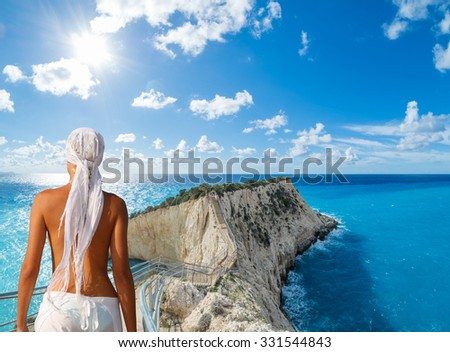 Woman on the beach looking  over Porto Katsiki beach in Lefkas island Greece - stock photo