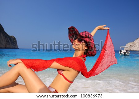 Woman on the beach posing for photographer - stock photo