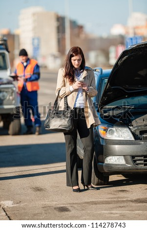 Woman on the phone after car crash breakdown talking upset - stock photo