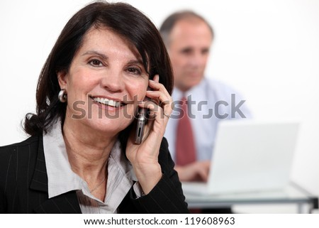 Woman on the phone with technicien - stock photo
