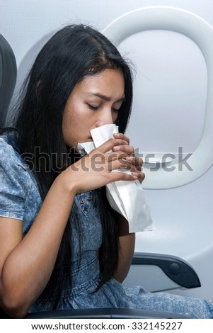 woman on the plane vomited in a paper bag - stock photo