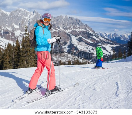 Woman On the Ski in winter resort - stock photo