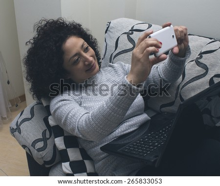 woman on the sofa with computer - stock photo