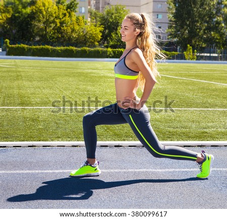 Woman on the stadium track. Woman summer fitness workout. Jogging, sport, healthy active lifestyle  concept - stock photo