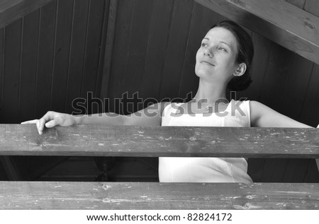 Woman on the terrace. - stock photo