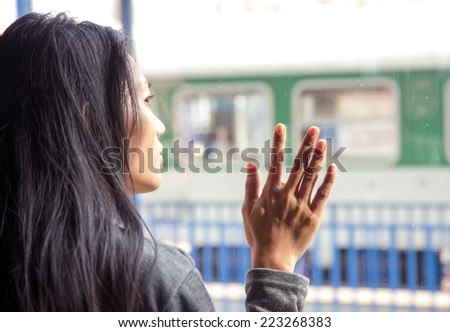 woman on the train looking out the window - stock photo