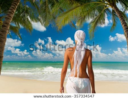 Woman on the Tropical beach of Lamai in Koh Samui island in Thailand - stock photo