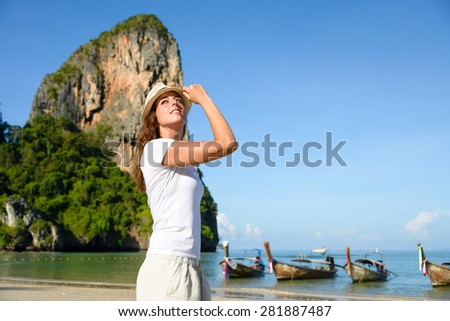 Woman on travel beach vacation at Krabi, Thailand. Brunette adult girl enjoying relax and tranquility at Railay Beach. - stock photo