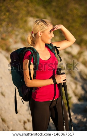 Woman on trekking - Beautiful blonde girl hiking on mountains - stock photo