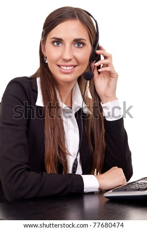 woman operator working with headset on helpdesk - stock photo