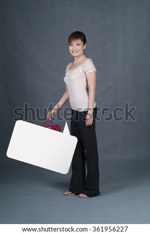 Woman or shopping woman with blank speech bubble - stock photo