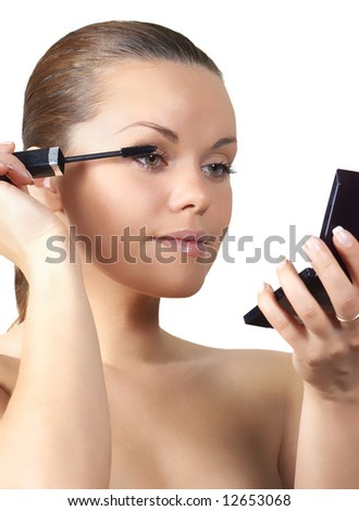 Woman painting eyelash (isolated on white) - stock photo