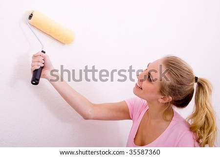 woman painting home - stock photo