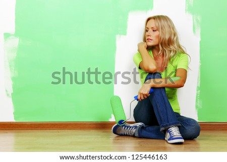 woman paints the wall brush isolated - stock photo