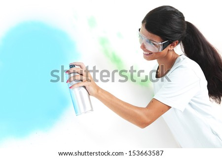 woman paints the wall of balon - stock photo