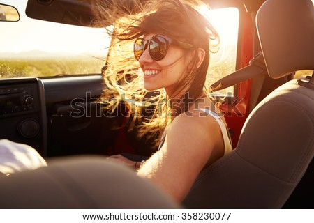 Woman Passenger On Road Trip In Convertible Car - stock photo
