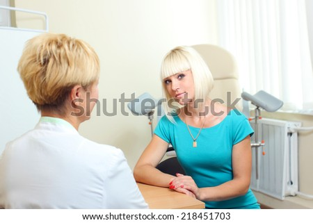 Woman patient talking to a gynecologist gynecology office. Woman in doctor's appointment - stock photo