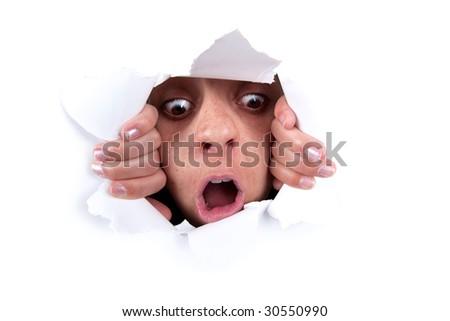 woman peeking behind white wall hole - stock photo