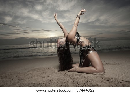 Woman performing a backwards stretch - stock photo