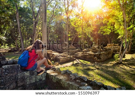 Woman photographing ancient Mayan ruins in Copan. Honduras  - stock photo