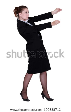 Woman placing objects on the wall - stock photo
