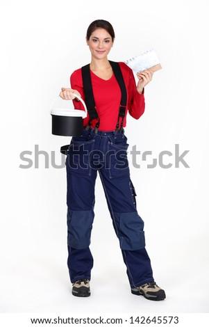 Woman plasterer on white background - stock photo
