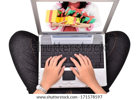 woman playing a laptop, with a prize in the monitor, isolated on white background - stock photo