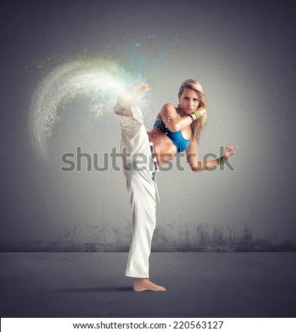 Woman playing capoeira with motion effect - stock photo