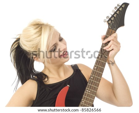 Woman playing electric guitar isolated on white - stock photo