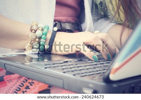 Woman playing on computer notebook - stock photo