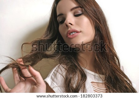 Woman playing with her hair - stock photo