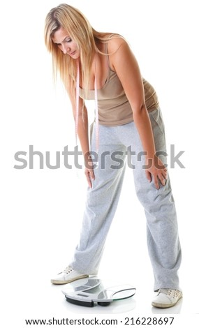 woman plus size large girl with weight scale measuring her weight controlling her dieting results, studio shot isolated on white - stock photo