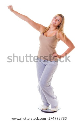 Woman plus size large happy girl with weight scale celebrating weightloss progress after diet victory, she lost some weight. Healthy lifestyles concept - stock photo