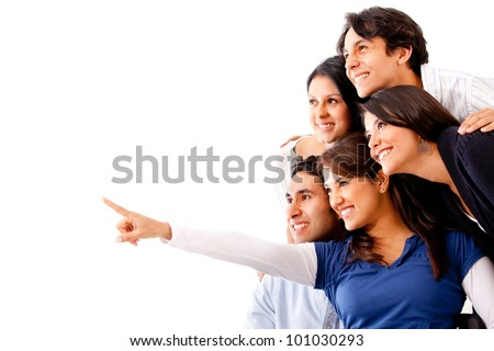 Woman pointing away and a group of people looking - isolated - stock photo
