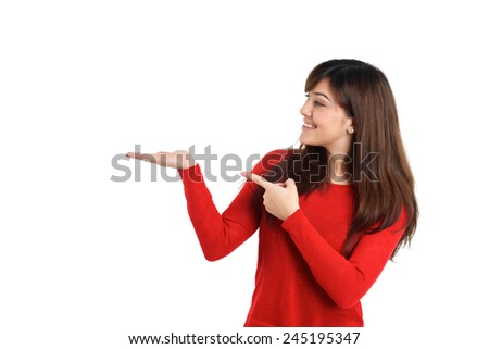 Woman pointing empty placeholder product on white background - stock photo