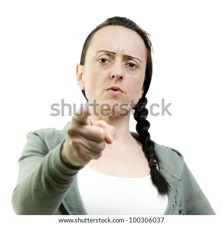 woman pointing looking angry on a white background - stock photo