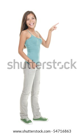 Woman pointing to the side standing in full length - isolated on white background. - stock photo