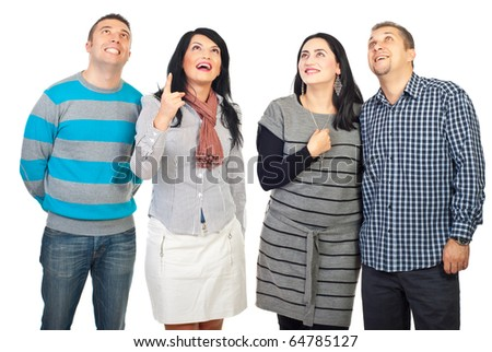 Woman pointing up and all group of friends looking up with happy surprised faces isolated on white background - stock photo