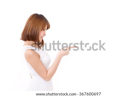 woman pointing up to blank space - stock photo