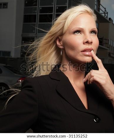 Woman pondering - stock photo