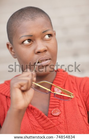 Woman pondering - stock photo