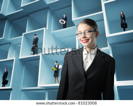woman portrait and businesspeople standing in 3d boxes background - stock photo