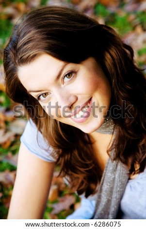 woman portrait in autumn where she is smiling and lokoing happy - stock photo